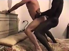 Interracial fuck standing on the bed