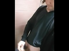 Long hair boy wank and cum in public toilet in shopping center