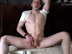 Vibrating the cum out of his uncut cock